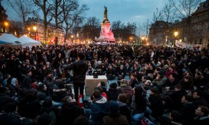 youth sit in republic square france