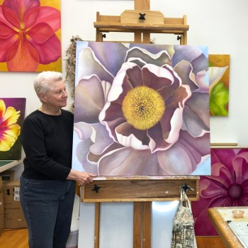 Mary Ahern in the studio with Subtle Exuberance - Tree Peony oil painting.