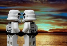 two lego storm troopers holding hands