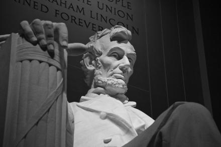 Abraham Lincoln sits alone for all to see.