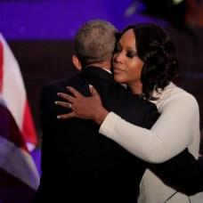 Maya Rockeymoore Cummings hugs former President Barack Obama during funeral services for her husband Rep. Elijah Cummings. (AP Photo/Julio Cortez, Pool)