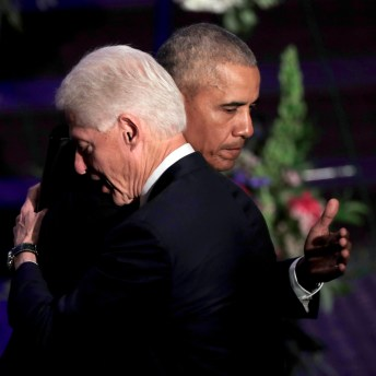 Former presidents Barack Obama and Bill Clinton hug at the end of funeral services for Rep. Elijah Cummings. (AP Photo/Julio Cortez, Pool)