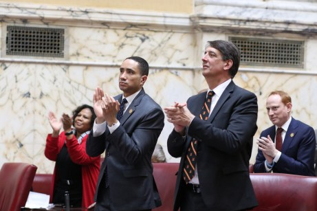 Senate Judicial Proceedings Chairman William C. Smith Jr. (D-Montgomery), left, and Senate Budget and Taxation Chairman Guy J. Guzzone (D-Howard) applaud the final moments of the 2020 legislative session. Photo by Hannah Gaskill