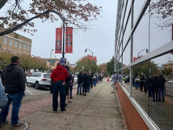 People waiting in line at early voting center in East Baltimore, Southeast Anchor Branch Library. Photo by Elizabeth Shwe.