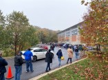 A line of voters snakes through the parking lot at the Pip Moyer Recreation Center in Annapolis on Oct. 26, 2020, the first day of early voting in Maryland. Photo by Bennett Leckrone.
