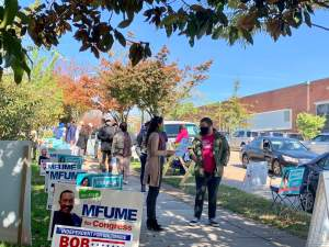 Franca Muller Paz, Green Party candidate for District 12 council in Baltimore City, talks with voters at Barclay Elementary/Middle School. Photo by Elizabeth Shwe