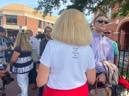 Andrea Chamblee, the widow of Capital Gazette shooting victim John McNamara, wore a shirt bearing his and other victims' names to the final day of the gunman's sanity trial Thursday. Photo by Hannah Gaskill.