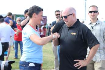 Gov. Lawrence J. Hogan, Jr. (R) and District 1 congressional candidate Heather Mizeur (D) share a fist bump at the 2021 J. Millard Tawes Crab and Clam Bake. Photo by Hannah Gaskill.