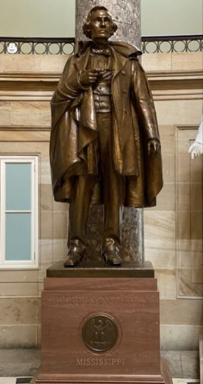 The statue of Confederate President Jefferson Davis stands in National Statuary Hall in the United States Capitol Building. Democrats led by House Majority Leader Steny Hoyer (D-Md.) want the statue and others associated with the Confederacy and white supremacy removed from the Capitol. Capital News Service photo by Michael Touma.