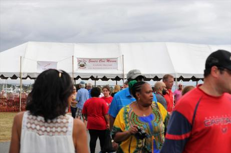 Visitors mill about the 2021 J. Millard Tawes Clam Bake and Crab Feast in Crisfield. Photo by Danielle E. Gaines.