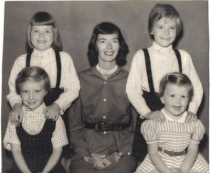 Portrait my mother had taken in Miami, 1955, of herself surrounded by us: Lizzie (top l), Nancy (top r), Sarah (lower r), me (lower l)