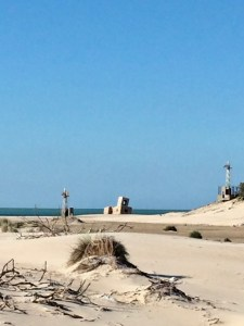 The beach near Chiclana de la Frontera near Cádiz on Christmas Day 2017. The ruin of a military tower on the horizon.