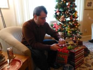 Jon opening a present