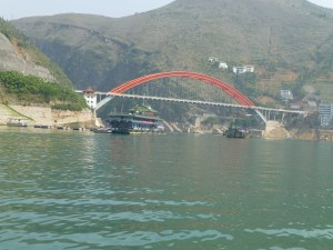 One of the excursion boats passes under a bridge