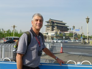 John in front of pagoda guarding entrance to Tiananmen Square and the Forbidden City