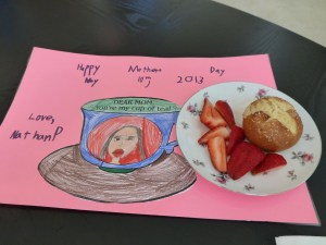 Nathan's placemat for his mom and a plate of strawberries and pretzel roll