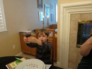 Sam raises his glass