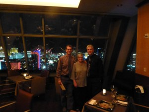 The three of us after dinner with Las Vegas lit up through the windows