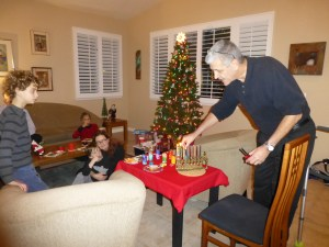 John lights the Hanukkah candles