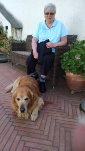 Mary and the aptly named golden retriever, Romeo