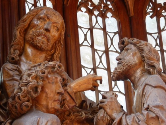 The central moment when Jesus hands the bread to Judas marking him as the traitor. Bag of coins in Judas's hand