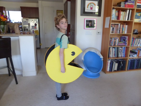 Nathan's costume is Pacman. The entire outline lights up and the open mouth is a receptacle for Halloween candy