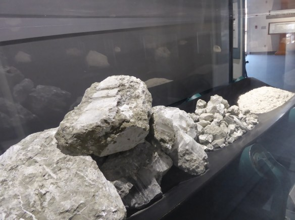 Unrefined ore from large rocks to fine granules