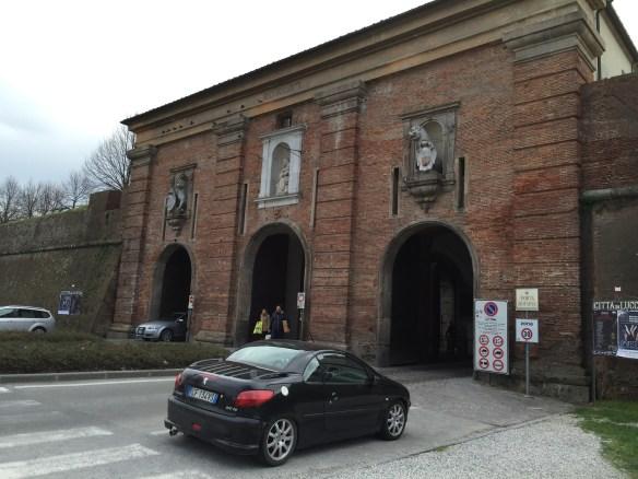 Entering the walled city of Luccathrough the Porta Santa Maria