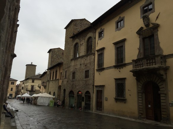 Wet Sansepulcro street with market in the background