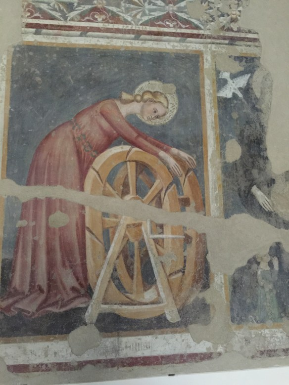 Poor St. Catherine being martyred on a wheel