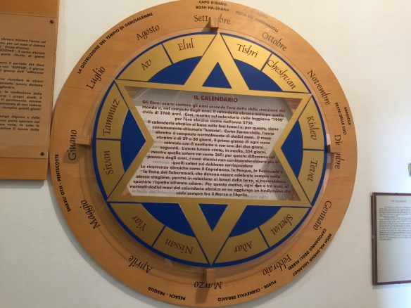 A display piece on the wall shows the Jewish calendar
