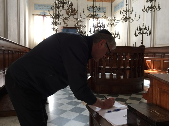 John signing the guest book