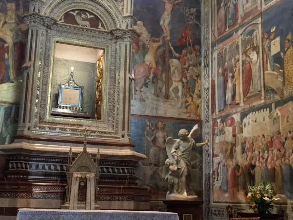 In this picture you can see the actual cloth here in the 21st century and two depictions of it in the 14th century frescoes!