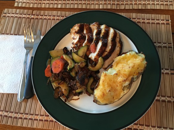 Chicken with stuffed potato and zucchini with carrot saute