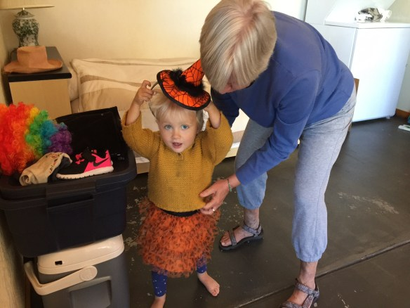 Eileen helps Vea into her Halloween skirt an hat