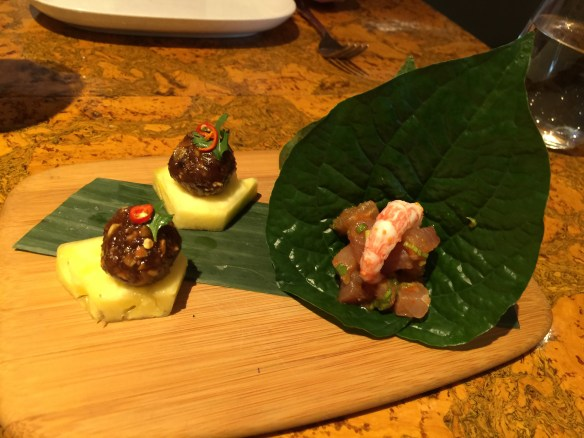 Kingfish and prawn on a betel leaf plus pork and chicken meatmall with chile and pineapple