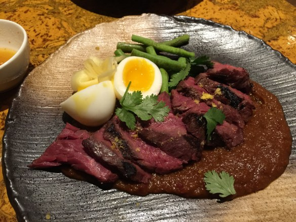 Hanger steak with red curry, egg, beans, cilantro and ginger