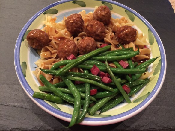Jon's favorite, meatballs and gravy over noodles with green beans