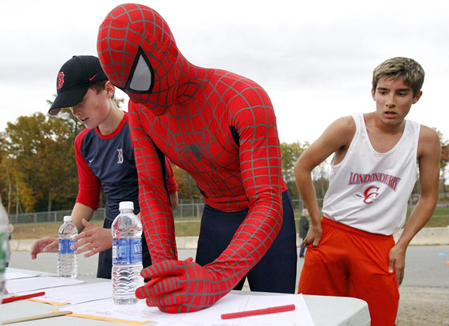 Londonderry Middle School art teacher Brandon Stumpf, dressed as spiderman, checks in with a second place finish after racing in the Community Walk/Run event at the school.