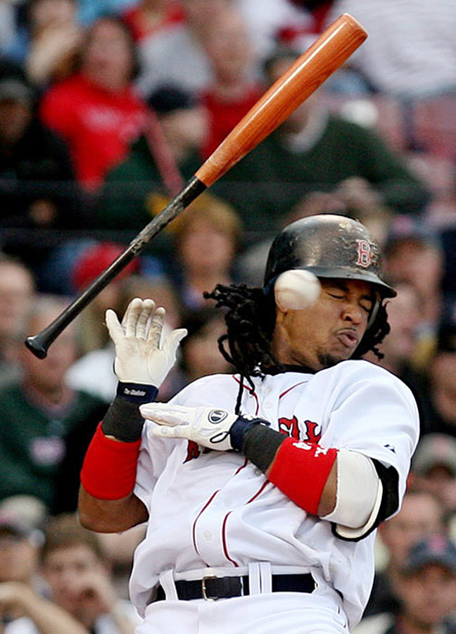 Boston Red Sox's Manny Ramirez (24) throws his bat as he is almost hit by a pitch by Milwaukee Brewers' Seth McClung during the seventh inning of the first game of their day-night baseball doubleheader on Saturday, May 17, 2008, in Boston.(AP Photo/Mary Schwalm)