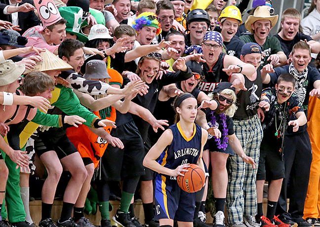 Pentucket fans stick their arms out as Arlington Catholic player Alexandra Ball prepares to inbound the ball on the sideline during the first half of their basketball game at St. John's Prep in Danvers. 3/2/15