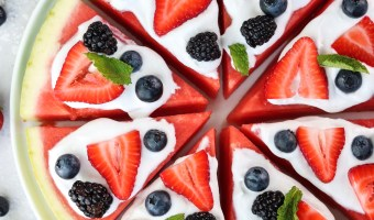 watermelon pizza with homemade coconut whipped cream and berries