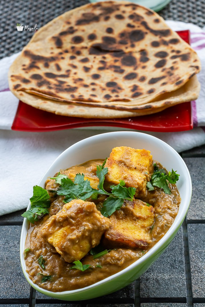 Paneer makhani served with parathas.