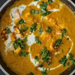 Paneer butter masala served in a pan
