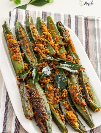 Stuffed Okra Recipe- stuffed bhindi served on a white plate.
