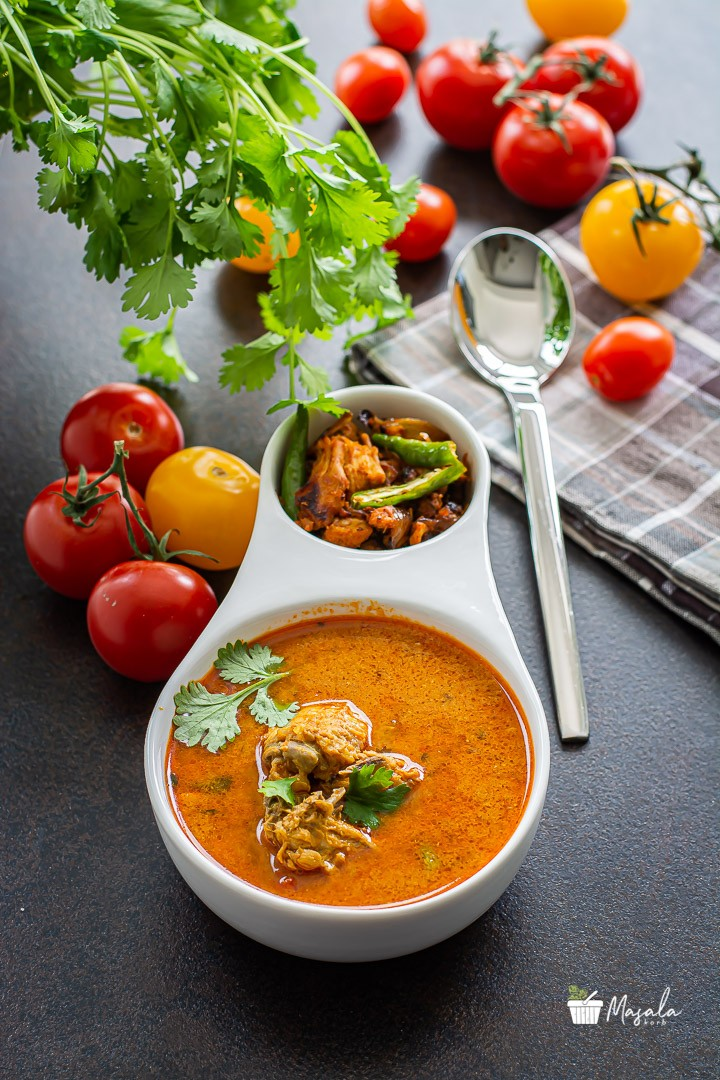 Chicken Rasam or Indian Style Chicken Soup with chicken fry served in a bowl.