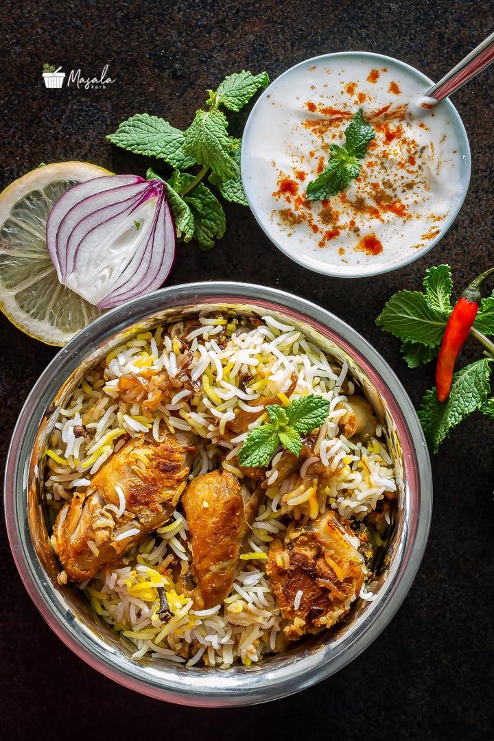 Chicken dum biryani hyderabadi style served with raita