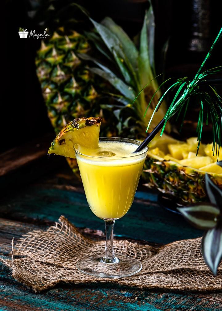 Enjoying tropical pineapple based drink in summer