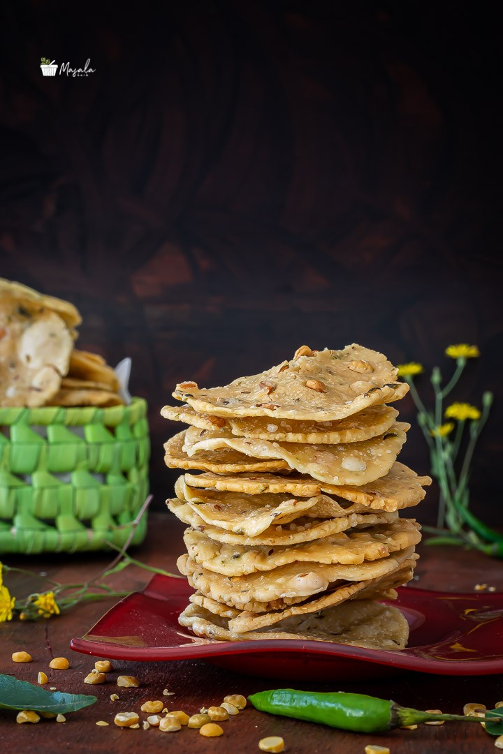 Chakkalu Savoury Rice Crackers stacked on a plate.
