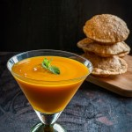 Aamras Puri served in a tall glass along with puris.